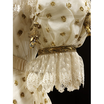 Blonde lace detail from a gown from the V & A Museum collection